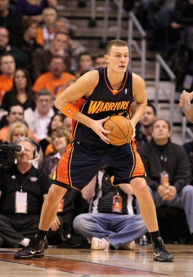 PHOENIX - JANUARY 23:  Andris Biedrins #15 of the Golden State Warriors during the NBA game against the Phoenix Suns at US Airways Center on January 23, 2010 in Phoenix, Arizona. The Suns defeated the Warriors 112-103.  NOTE TO USER: User expressly acknow