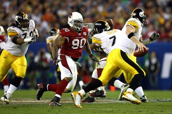 TAMPA, FL - FEBRUARY 01:  Darnell Dockett #90 of the Arizona Cardinals pressures quarterback Ben Roethlisberger #7 of the Pittsburgh Steelers past the block of Darnell Stapleton #72 during Super Bowl XLIII on February 1, 2009 at Raymond James Stadium in T