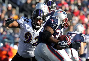 FOXBORO, MA - JANUARY 10:  Haloti Ngata #92 of the Baltimore Ravens attempts to stop Kevin Faulk #33 of the New England Patriots during the 2010 AFC wild-card playoff game at Gillette Stadium on January 10, 2010 in Foxboro, Massachusetts. The Ravens won 3