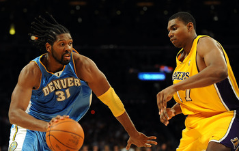 LOS ANGELES, CA - MAY 27:  Nene #31 of the Denver Nuggets drives on Andrew Bynum #17 of the Los Angeles Lakers in the second quarter of Game Five of the Western Conference Finals during the 2009 NBA Playoffs at Staples Center on May 27, 2009 in Los Angele