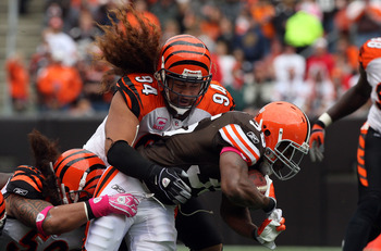 CLEVELAND - OCTOBER 04:  Jerome Harrison #35 of the Cleveland Browns is tackled by Domata Peko #94 of the Cincinnati Bengals during their game at Cleveland Browns Stadium on October 4, 2009 in Cleveland, Ohio. The Bengals defeated the Browns 23-20 in over