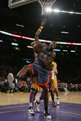 LOS ANGELES - MARCH 26:  Nazr Mohammed #6 of the Charlotte Bobcats pulls down a rebound during the game against the Los Angeles Lakers on March 26, 2008 at Staples Center in Los Angeles, California.  The Bobcats won 108-95.  NOTE TO USER: User expressly a