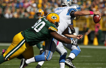 GREEN BAY, WI - OCTOBER 03: B.J. Raji #90 of the Green Bay Packers sacks Shaun Hill #14 of the Detroit Lions at Lambeau Field on October 3, 2010 in Green Bay, Wisconsin. The Packers defeated the Lions 28-26. (Photo by Jonathan Daniel/Getty Images)