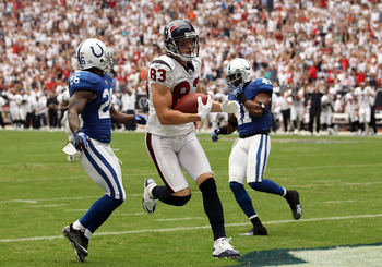 HOUSTON - SEPTEMBER 12:  Wide receiver Kevin Walter #83 of the Houston Texans runs for a touchdown past Kelvin Hayden #26 of the Indianapolis Colts during the NFL season opener at Reliant Stadium on September 12, 2010 in Houston, Texas.  (Photo by Ronald