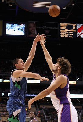 PHOENIX - MARCH 16:  Darko Milicic #31 of the Minnesota Timberwolves puts up a shot over Robin Lopez #15 of the Phoenix Suns during the NBA game at US Airways Center on March 16, 2010 in Phoenix, Arizona. The Suns defeated the Timberwolves 152-114.  NOTE