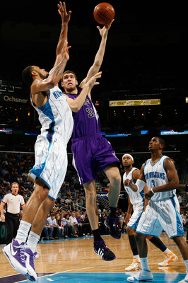 NEW ORLEANS - DECEMBER 20:  Spencer Hawes #31 of the Sacramento Kings makes a shot over Tyson Chandler #6 of the New Orleans Hornets on December 20, 2008 in New Orleans, Louisiana.   The Hornets defeated the Kings 99-90.   NOTE TO USER: User expressly ack