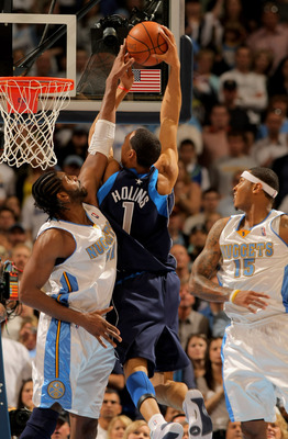 DENVER - MAY 03:  Nene #31 of the Denver Nuggets defends on a shot by Ryan Hollins #1 of the Dallas Mavericks in Game One of the Western Conference Semifinals during the 2009 NBA Playoffs at Pepsi Center on May 3, 2009 in Denver, Colorado. The Nuggets def