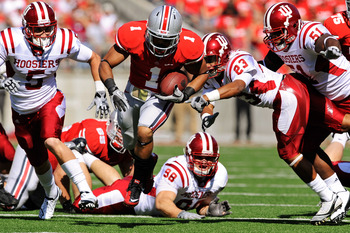 COLUMBUS, OH - OCTOBER 9:  Dan Herron #1 of the Ohio State Buckeyes takes off through the Indiana Hoosiers' defense on a 39-yard touchdown run in the first quarter at Ohio Stadium on October 9, 2010 in Columbus, Ohio.  (Photo by Jamie Sabau/Getty Images)