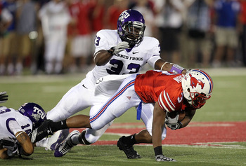 DALLAS - SEPTEMBER 24:  Wide receiver Darius Johnson #3 of the SMU Mustangs is tackled by Kris Gardner #33 of the TCU Horned Frogs at Gerald J. Ford Stadium on September 24, 2010 in Dallas, Texas.  (Photo by Ronald Martinez/Getty Images)