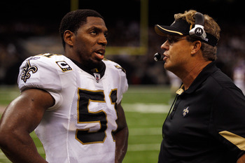 NEW ORLEANS - SEPTEMBER 09:  Jonathan Vilma #51 talks with Gregg Williams of the New Orleans Saints during the game against the Minnesota Vikings at Louisiana Superdome on September 9, 2010 in New Orleans, Louisiana.  (Photo by Chris Graythen/Getty Images