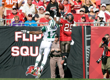 TAMPA, FL - DECEMBER 13:  Cornerback Aqib Talib #25 of the Tampa Bay Buccaneers breaks up a pass intended for receiver Braylon Edwards #17 of the New York Jets during the game at Raymond James Stadium on December 13, 2009 in Tampa, Florida.  (Photo by J.