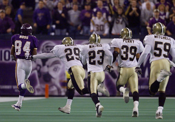 06 Jan 2001:  Wide receiver Randy Moss #84 of the Minnesota Vikings takes off on a 68-yard touchdown reception with the New Orleans Saints defense in tow during the third quarter at the Metrodome in Minneapolis, Minnesota.   The Vikings won 34-16 to advan