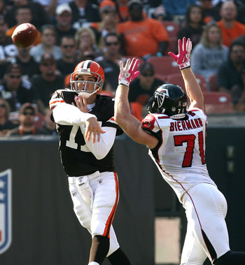 CLEVELAND - OCTOBER 10:  Quarterback Jake Delhomme #17 of the Cleveland Browns throws to a receiver as he is pressured by outside tackle Kroy Biermann #71 of the Atlanta Falcons at Cleveland Browns Stadium on October 10, 2010 in Cleveland, Ohio.  (Photo b