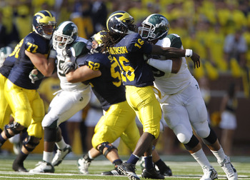 ANN ARBOR, MI - OCTOBER 09:  Jerel Worthy #99 of the Michigan State Spartans rushes Denard Robinson #16 of the Michigan Wolverines during the game on October 9, 2010 at Michigan Stadium in Ann Arbor, Michigan. The Michigan State Spartans defeated the Mich