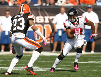 CLEVELAND - OCTOBER 10:  Wide receiver Eric Weems #14 of the Atlanta Falcons runs the ball by defensive back Joe Haden #23 of the Cleveland Browns at Cleveland Browns Stadium on October 10, 2010 in Cleveland, Ohio.  (Photo by Matt Sullivan/Getty Images)