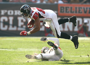CLEVELAND - OCTOBER 10:  Tight end Tony Gonzalez #88 of the Atlanta Falcons dives over defensive back Eric Wright #21 of the Cleveland Browns at Cleveland Browns Stadium on October 10, 2010 in Cleveland, Ohio.  (Photo by Matt Sullivan/Getty Images)