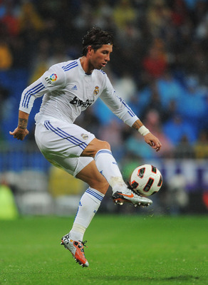 MADRID, SPAIN - OCTOBER 03:  Sergio Ramos of Real Madrid crosses the ball  during their La Liga match against Deportivo La Coruna  at Estadio Santiago Bernabeu on October 3, 2010 in Madrid, Spain.  (Photo by Denis Doyle/Getty Images)