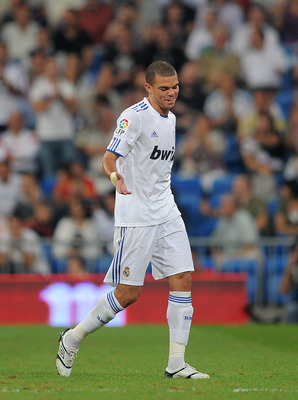 MADRID, SPAIN - SEPTEMBER 21:  Pepe of Real Madrid leaves the field after being shown the red card by refere Clos Gomez during the La Liga match between Real Madrid and Espanyol at Estadio Santiago Bernabeu on September 21, 2010 in Madrid, Spain.  (Photo