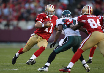 SAN FRANCISCO - OCTOBER 10:  Alex Smith #11 of the San Francisco 49ers runs against the Philadelphia Eagles during an NFL game at Candlestick Park on October 10, 2010 in San Francisco, California.(Photo by Jed Jacobsohn/Getty Images)