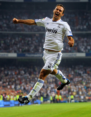 MADRID, SPAIN - SEPTEMBER 11: Ricardo Carvalho of Real Madrid celebrates after scoring his team's first goal during the La Liga match between Real Madrid and Osasuna at Estadio Santiago Bernabeu on September 11, 2010 in Madrid, Spain.  (Photo by Denis Doy