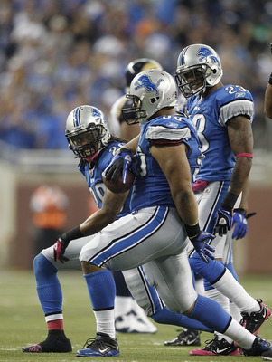 DETROIT - OCTOBER 10: Louis Delmas #26 and Ndamukong Suh #90 of the Detroit Lions celebrate Suh's fourth quarter interception during the game against the St. Louis Rams at Ford Field on October 10, 2010 in Detroit, Michigan.  The Lions defeated the Rams 4