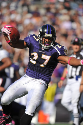 BALTIMORE, MD - OCTOBER 10:  Ray Rice #27 of the Baltimore Ravens celebrates his second touchdown against the Denver Broncos at M&T Bank Stadium on October 10, 2010 in Baltimore, Maryland. Players wore pink in recognition of Breast Cancer Awareness Month.