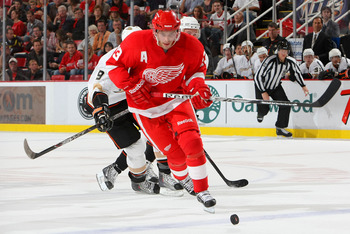DETROIT - OCTOBER 8:  Pavel Datsyuk #13 of the Detroit Red Wings skates after a loose puck against the Anaheim Ducks at Joe Louis Arena on October 8, 2010 in Detroit, Michigan.(Photo By Dave Sandford/Getty Images)