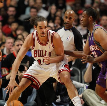 CHICAGO - MARCH 30: Joakim Noah #13 of the Chicago Bulls moves against Jarron Collins #20 of the Phoenix Suns at the United Center on March 30, 2010 in Chicago, Illinois. The Suns defeated the Bulls 111-105. NOTE TO USER: User expressly acknowledges and a