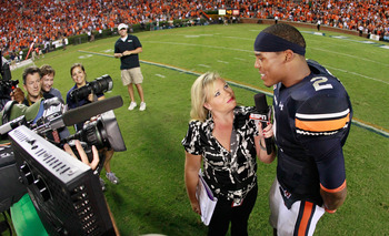 AUBURN, AL - SEPTEMBER 25:  ESPN reporter Holly Rowe interviews quarterback Cameron Newton #2 of the Auburn Tigers after their 35-27 win over the South Carolina Gamecocks at Jordan-Hare Stadium on September 25, 2010 in Auburn, Alabama.  (Photo by Kevin C.