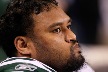 INDIANAPOLIS - JANUARY 24:  Sione Pouha #91 of the New York Jets looks on from the sidelines during the fourth quarter of the game against the Indianapolis Colts during the AFC Championship Game at Lucas Oil Stadium on January 24, 2010 in Indianapolis, In
