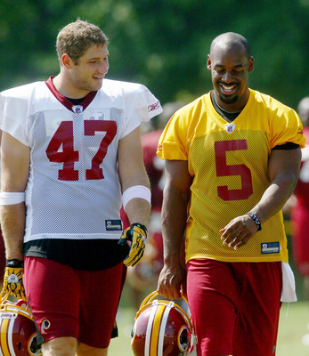 ASHBURN, VA - AUGUST 06:  Quarterback Donovan McNabb #5 of the Washington Redskins and tight end Chris Cooley #47 walk off the field following practice during Redskins training camp on August 6, 2010 in Ashburn, Virginia.  (Photo by Win McNamee/Getty Imag