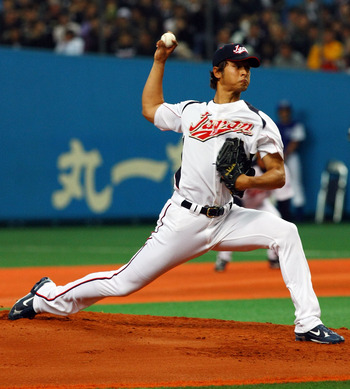 OSAKA, JAPAN - FEBRUARY 24:  Starting Pictcher Yu Darvish #11 of Japan pitches during an exhibition match between Japan and Australia at Kyocera Dome Osaka on February 24, 2009 in Osaka, Japan.  (Photo by Junko Kimura/Getty Images)