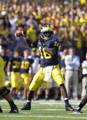 ANN ARBOR, MI - OCTOBER 09: Denard Robinson #16 of the Michigan Wolverines drops back to pass in the second quarter during the game against the Michigan State Spartans on October 9, 2010 at Michigan Stadium in Ann Arbor, Michigan. (Photo by Leon Halip/Get