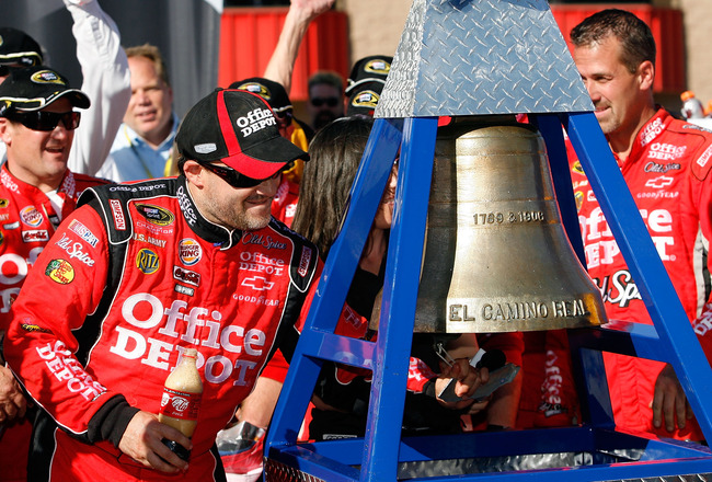 FONTANA, CA - OCTOBER 10:  Tony Stewart (L), driver of the #14 Office Depot Chevrolet, celebrates in victory lane after winning the NASCAR Sprint Cup Series Pepsi Max 400 on October 10, 2010 in Fontana, California.  (Photo by Tom Pennington/Getty Images f