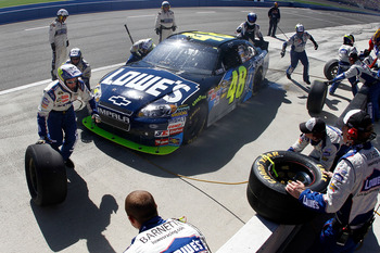 FONTANA, CA - OCTOBER 10:  Jimmie Johnson, driver of the #48 Lowe's/Jimmie Johnson Foundation Chevrolet, makes a pit stop during the NASCAR Sprint Cup Series Pepsi Max 400 on October 10, 2010 in Fontana, California.  (Photo by Jason Smith/Getty Images for