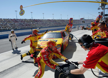 FONTANA, CA - OCTOBER 10:  Kevin Harvick, driver of the #29 Shell/Pennzoil Chevrolet, makes a pit stop during the NASCAR Sprint Cup Series Pepsi Max 400 on October 10, 2010 in Fontana, California.  (Photo by Tom Pennington/Getty Images for NASCAR)