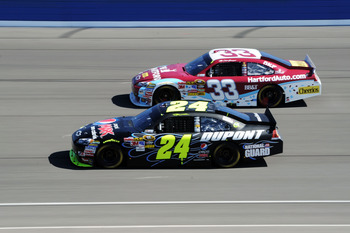 FONTANA, CA - OCTOBER 10:  Jeff Gordon, driver of the #24 DuPont Chevrolet, races Clint Bowyer, driver of the #33 The Hartford Chevrolet, during the NASCAR Sprint Cup Series Pepsi Max 400 on October 10, 2010 in Fontana, California.  (Photo by Harry How/Ge