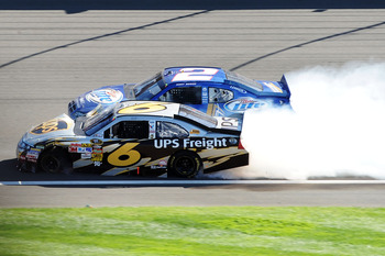 FONTANA, CA - OCTOBER 10:  David Ragan, driver of the #6 UPS Ford, and Kurt Busch, driver of the #2 Miller Lite Dodge, crash in to each other during the NASCAR Sprint Cup Series Pepsi Max 400 on October 10, 2010 in Fontana, California.  (Photo by Harry Ho