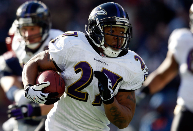FOXBORO, MA - JANUARY 10:  Ray Rice #27 of the Baltimore Ravens runs the ball against the New England Patriots during the 2010 AFC wild-card playoff game at Gillette Stadium on January 10, 2010 in Foxboro, Massachusetts.  (Photo by Elsa/Getty Images)
