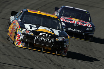 FONTANA, CA - OCTOBER 10:  Jeff Burton, driver of the #31 Caterpilliar Chevrolet, leads Reed Sorenson, driver of the #83 Red Bull Toyota, during the NASCAR Sprint Cup Series Pepsi Max 400 on October 10, 2010 in Fontana, California.  (Photo by Jeff Gross/G