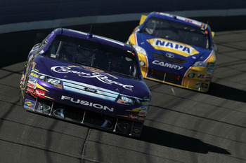 FONTANA, CA - OCTOBER 10:  Matt Kenseth, driver of the #17 Crown Royal Ford, leads Martin Truex Jr., driver of the #56 NAPA Toyota, during the NASCAR Sprint Cup Series Pepsi Max 400 on October 10, 2010 in Fontana, California.  (Photo by Jeff Gross/Getty I