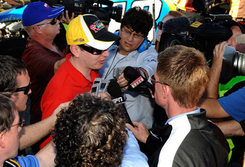 FONTANA, CA - OCTOBER 10:  Kyle Busch, driver of the #18 M&M'sToyota, speaks to the media after blowing a motor during the NASCAR Sprint Cup Series Pepsi Max 400 on October 10, 2010 in Fontana, California.  (Photo by Rusty Jarrett/Getty Images for NASCAR)