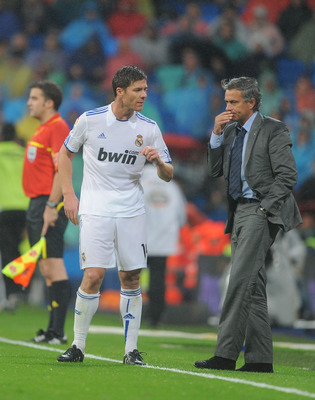 MADRID, SPAIN - OCTOBER 03:  Real Madrid's manager Jose Mourinho has a word with Xabi Alonso during the La Liga match between Real Madrid and  Deportivo La Coruna  at Estadio Santiago Bernabeu on October 3, 2010 in Madrid, Spain. (Photo by Denis Doyle/Get