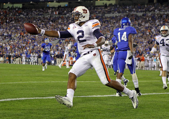 LEXINGTON, KY - OCTOBER 09:  Cam Newton #2 of the Auburn Tigers celebrates after scoring a touchdown during the SEC game against the Kentucky Wildcats at Commonwealth Stadium on October 9, 2010 in Lexington, Kentucky.  (Photo by Andy Lyons/Getty Images)