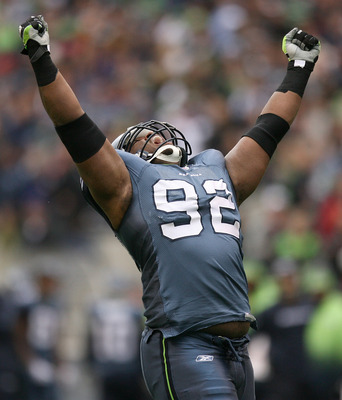 SEATTLE - NOVEMBER 08:  Defensive tackle Brandon Mebane #92 of the Seattle Seahawks celebrates after sacking the quarterback against the Detroit Lions on November 8, 2009 at Qwest Field in Seattle, Washington. The Seahawks defeated the Lions 32-20. (Photo