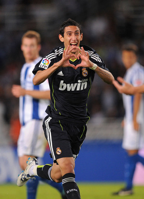 SAN SEBASTIAN, SPAIN - SEPTEMBER 18:  Angel di Maria of Real Madrid celebrates after scoring Real's first goal during the La Liga match between Real Sociedad and Real Madrid at Estadio Anoeta on September 18, 2010 in San Sebastian, Spain.  (Photo by Denis