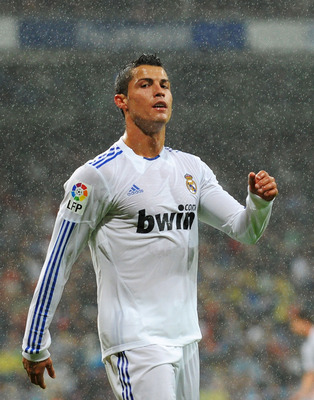 MADRID, SPAIN - OCTOBER 03:  Cristiano Ronaldo of Real Madrid waits for corner kick to be taken during their La Liga match against Deportivo La Coruna  at Estadio Santiago Bernabeu on October 3, 2010 in Madrid, Spain.  (Photo by Denis Doyle/Getty Images)