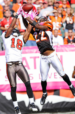 CINCINNATI, OH - OCTOBER 10:  Johnathan Joseph #22 of the Cincinnati Bengals breaks up a pass intended for Sammie Stroughter #18 of the Tampa Bay Buccaneers at Paul Brown Stadium on October 10, 2010 in Cincinnati, Ohio.  (Photo by Jamie Sabau/Getty Images