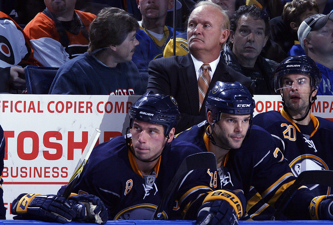 BUFFALO - OCTOBER 3:  Head Coach Lindy Ruff  looks on as Cody McCormick #8, Paul Gaustad #28 and Rob Niedermayer #20 all of the Buffalo Sabres sit on the bench as play goes on  against the Philadelphia Flyers during their NHL game at HSBC Arena October 3,