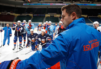UNIONDALE, NY - SEPTEMBER 21: Head Coach Scott Gordon of the New York Islanders conducts practice during a training camp session on September 21, 2010 at Nassau Coliseum in Uniondale.  (Photo by Mike Stobe/Getty Images)